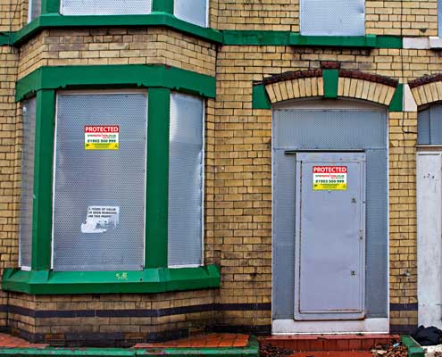 image of a vacant property with steel shuttering
