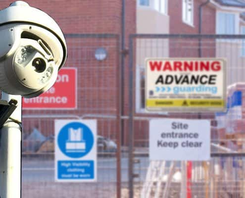 Warning signs and cctv on a building site