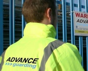 Advance Guarding uniformed guard patrolling a building site